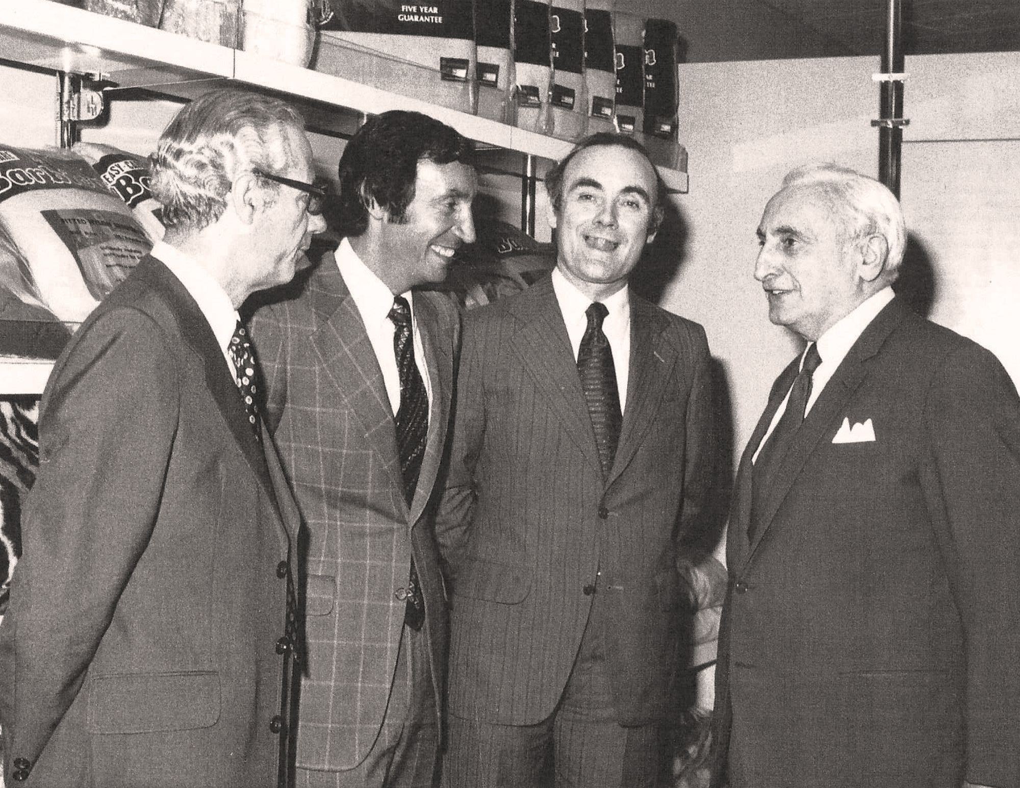 Far Right Maurice Phillips (Founder); Middle Right, Selfridges Buyer; Middle Left, Malcolm Phillips (2nd Generation); Far Left, Phillip Dew (An employee of the Original Maurice Phillips Company) Photo Taken 1982.